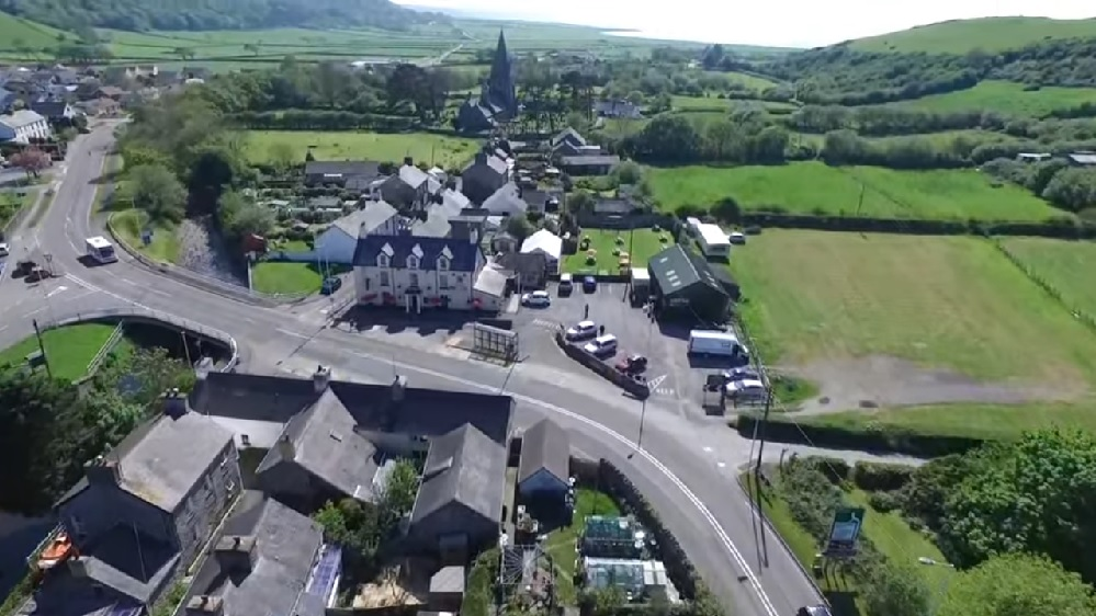 Aerial view of Llanrhystud including the Black Lion and distant views of the Church.