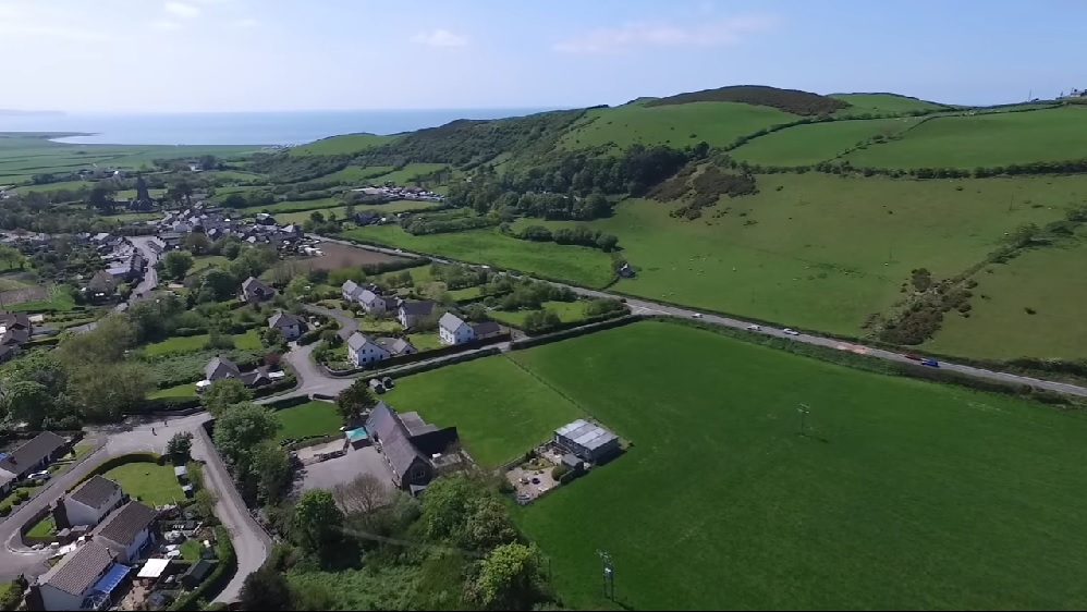 Arial view of Llanrhystud, Ceredigion situated on the coastline of Cardigan Bay, Wales.
