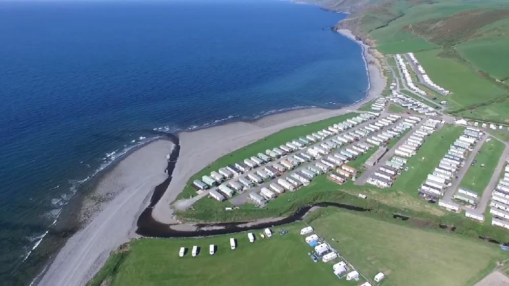Aerial view of Pengarreg Caravan Park, Llanrhystud, with coastline of Cardigan Bay