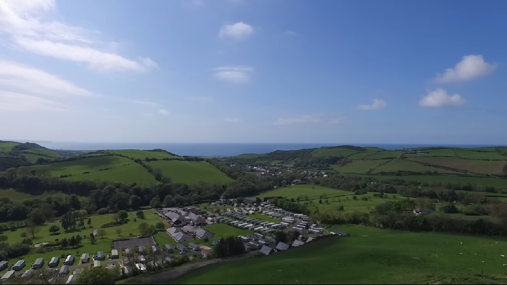 Arial view of Penrhos Caravan Park and golf club with distant views of Cardigan Bay, Wales.