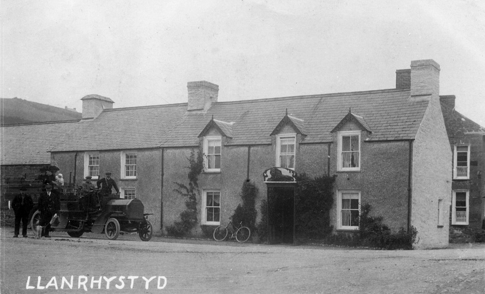 Early photo of Red Lion pub Llanrhystud, Ceredigion, with a Milnes Daimler lorry parked outside.